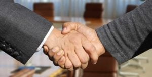 make a good first impression with a firm handshake